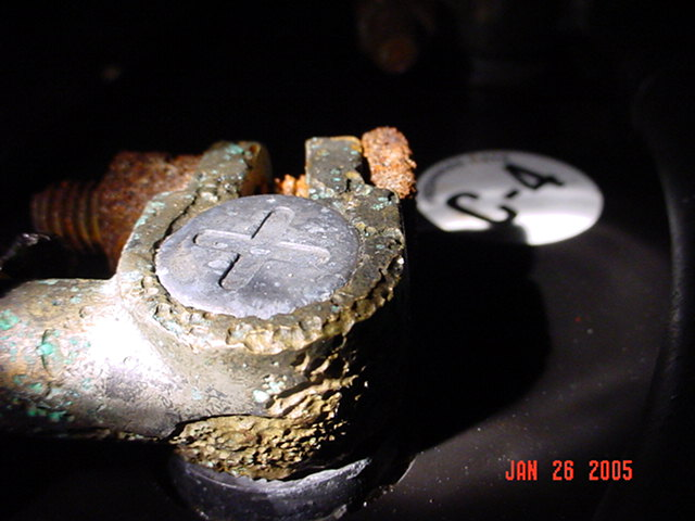 This battery terminal was submerged when the engine compartment filled with water from a hurricane.  Note the stray current corrosion on the positive terminal (which was the anode in this stray current cell).  It provides evidence that this battery terminal was covered with water at one time.