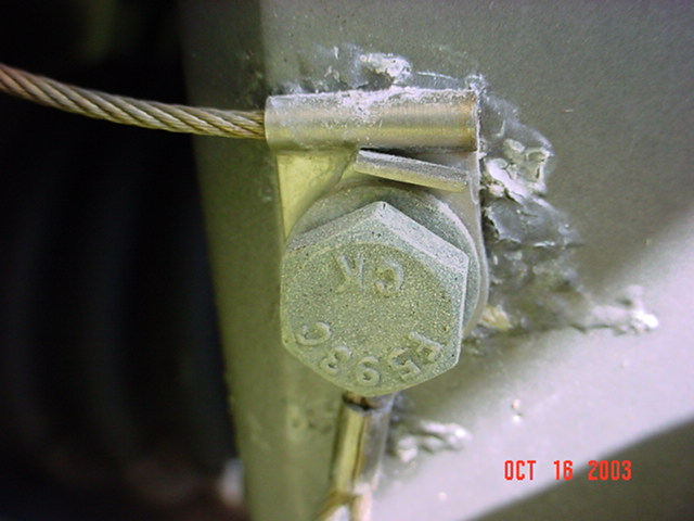 Here a stainless fastener was not isolated from the aluminum casing and the aluminum was corroding under the paint (which was probably not properly applied).